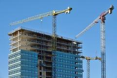 Construction progressing of office building Stock Photos