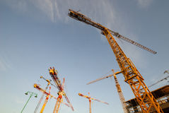 Construction project. Cranes in large scale project stock photography
