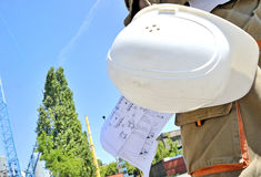 Construction Project Architect. With hat and project Stock Photography