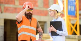 Construction project inspecting. Construction inspection, corrections and fines. Safety inspector concept. Discuss. Progress project. Inspector and bearded stock images