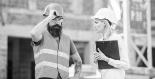 Construction project inspecting. Construction inspection, corrections and fines. Safety inspector concept. Discuss. Progress project. Inspector and bearded stock photo