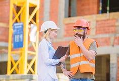 Construction project management. Building industrial project. Construction industry concept. Discuss progress project stock photo