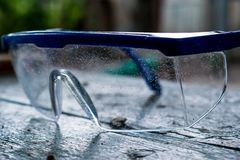 Construction, protective, transparent plastic glasses in blue frame royalty free stock photo