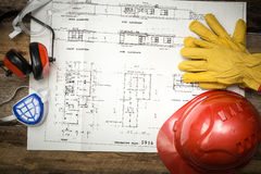 Construction protective workwear with plans Royalty Free Stock Images