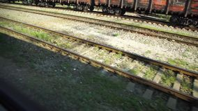 Construction of a railway line for a tram with rails, gravel and sleepers. The construction of a railway line for a tram with rails, gravel and underlay sleepers stock footage