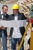 Construction readers. Two construction workers read paper Royalty Free Stock Photography