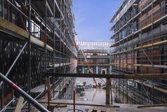 Construction or renovation of building. Multi-story building under construction or renovation with scaffolding stock photos