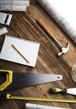 Construction and renovation concept. Place for typography or text. Blueprints and building contractor tools on wooden table. Top view stock image