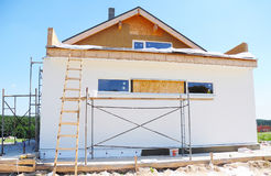Construction or repair of the rural house with insulation, eaves,  roofing Royalty Free Stock Images