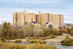 Construction of a residential complex on the bank of the river Royalty Free Stock Images