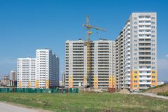 Construction of residential complex of typical sixteen-storey block houses Stock Photos