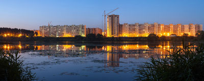 Construction of residential houses on the banks of the river in Royalty Free Stock Photo