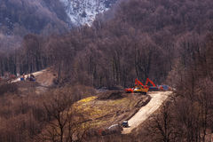The construction of the road on the hillside in the spring. In April Stock Photo