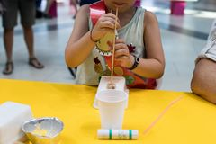Construction of a robot from waste materials. STEM activities for children on technology, electronics, robotics and circular econ. Omy. Recycling of waste stock image
