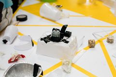 Construction of a robot from waste materials. STEM activities for children on technology, electronics, robotics and circular econ. Omy. Recycling of waste royalty free stock image