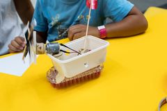 Construction of a robot from waste materials. STEM activities for children on technology, electronics, robotics and circular econ. Omy. Recycling of waste royalty free stock photo