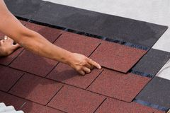 Construction of a roof. Construction of asphalt shingles on a roof of wood Stock Images