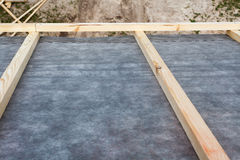 Construction the roof of a new house. Waterproof layering. Royalty Free Stock Image