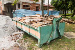 Construction rubbish bin with loads at construction site Royalty Free Stock Photos