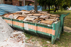 Construction rubbish bin with loads at construction site Stock Image