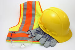 Construction Safety Apparel. A hard hat, protective gloves, reflective safety vest, and safety glasses Stock Photo