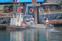 Construction and Safety Apparel. Construction workers use life vests when working in and near water Stock Photo