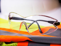 Construction safety equipment. Glasses, vest and hard hat Royalty Free Stock Images