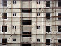 Construction scaffolding. Scaffolding on outside of a building under construction Royalty Free Stock Image