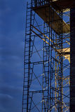 Construction scaffolding against nighttime sky Stock Image