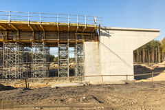 Construction scaffolding built under an overpass over the highw Stock Images