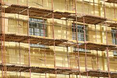 Construction scaffolding on the facade of the house. Royalty Free Stock Photography
