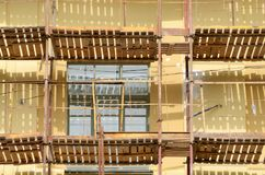 Construction scaffolding on the facade of the house. Stock Photography