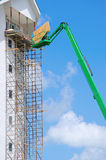 Construction scaffolding and lift on tall buiding Stock Photography