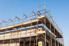 House under construction with scaffolding. Royalty Free Stock Photos