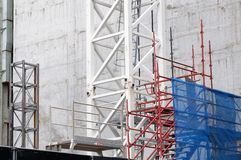 Construction Scaffolding and Safety Cladding. A Sydney Australia construction site, with detail of scaffolding, blue safety or security mesh cladding and a white stock images