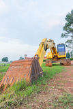 Construction scoop. An excavator sits at a construction site Royalty Free Stock Image