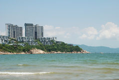 Construction and sea. West the Chinese Guangdong Shenzhen flushes the seashore resort, the sea and the building complements Royalty Free Stock Photography