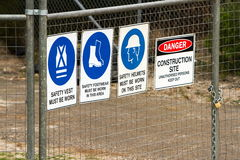 Construction security fence with signs Royalty Free Stock Image