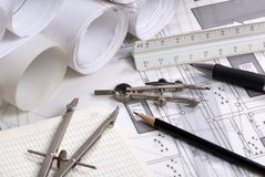 Construction Series 011. An engineer's work table with drawings and tools of the trade Royalty Free Stock Image