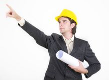 Construction series. Construction engineer in suit holding blueprints Stock Photography