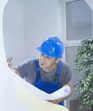 Construction series. Construction engineer working on blueprints Royalty Free Stock Photos