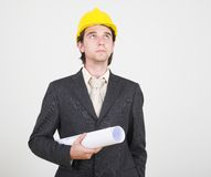 Construction series. Construction engineer in suit holding blueprints Royalty Free Stock Photography
