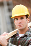Construction: Serious Worker on Home Site Royalty Free Stock Image