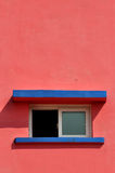 Construction shape and color. A small window and shadow on pink color wall, shown as geometric shape and color of the architecture Stock Images