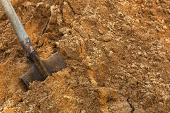 Construction shovel stuck in the sand. break during work Royalty Free Stock Photography