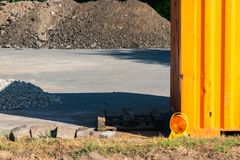 Construction side with pallet, lamp, container and a pile of gravel stock photo