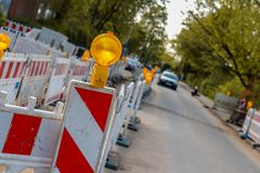 Construction side at a pedestrian way, illuminated barricades ar royalty free stock image