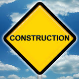 Construction Sign. Bright yellow construction sign with blue sky background royalty free illustration