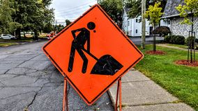 Construction sign on a street. That needs repair in a residential area stock photo