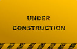 Construction signboard on yellow background Stock Photography